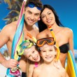 Happy fun family with two children at tropical beach — Stock Photo #21943643