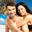 Happy beautiful couple in love at tropical beach — Stock Photo