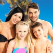 Happy family with two children at tropical beach — Stock Photo #21943793