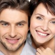 Stock Photo: Closeup face of beautiful happy couple - isolated