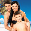 Happy family with child at tropical beach — Stock Photo #21943833