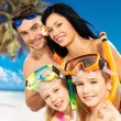 Stock Photo: Happy fun family with two children at tropical beach