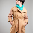 Beautiful woman in autumn coat with green scarf — Stock Photo