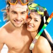 Fun beautiful couple at tropical beach with swimming mask — Stock Photo #21944067