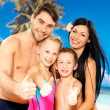 Happy smiling family with thumbs up sign - Stock Photo