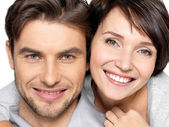 Closeup face of beautiful happy couple - isolated — Zdjęcie stockowe
