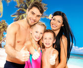Happy smiling family with thumbs up sign — Stock Photo