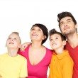 Happy family with two children looking up — Stock Photo #22209521