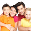 Stock Photo: Happy family with two children on white