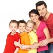 Happy family with children standing together in line — Stock Photo