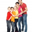 Happy family with three children standing together - Foto Stock