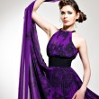 Stock Photo: Beautiful fashion woman in purple long dress