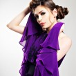 Beautiful fashion woman in purple long dress — Stock Photo #22209825