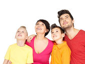 Happy family with two children looking up — Stock Photo
