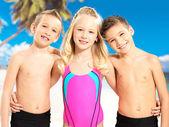 Portrait of the happy children enjoying at beach — Stock Photo