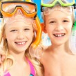 Portrait of the brother with sister enjoying at beach - Stock Photo
