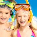 Portrait of the happy children enjoying at beach — Stock Photo #22211447