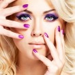 Beautiful woman with beauty purple manicure and makeup of eyes. — Stock Photo #22223997