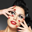 Woman with red nails and creative hairstyle — Stock Photo #22224147