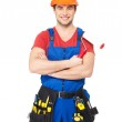 Portrait of smiling handyman with tools — Stock Photo