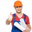 Handyman with paper showing thumbs up sign — Stock Photo #22508375