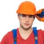 Portrait of thinking handyman in uniform — Stock Photo