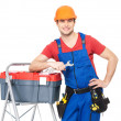 Smiling manual worker with tools - Stock Photo