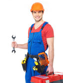 Portrait of smiling worker with tools — Stock Photo