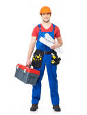 Smiling handyman with tools and paper — Stock Photo