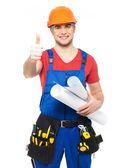 Handyman with paper showing thumbs up sign — Stock Photo