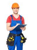 Dělník s nástroji, plánování a psaní poznámky — Stock fotografie