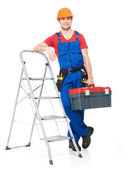 Craftsman with tools and stairs — Stock Photo