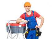 Smiling manual worker with tools — Stock Photo