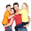 Happy family with two schoolchild children - Stock Photo