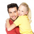 Portrait of the happy father with pretty daughter - Stock Photo