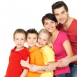 Happy family with children standing together in line - Stock Photo