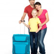 Royalty-Free Stock Photo: Happy family with  suitcase  at studio