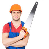 Smiling manual worker with saw — Stock Photo