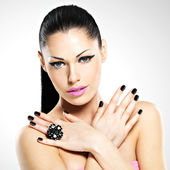 Face of the beautiful woman with black nails and pink lips — Stock Photo