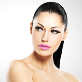 Face of the beautiful woman with fashion makeup — Stock Photo