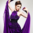 Beautiful fashion woman in purple long dress — Stock Photo