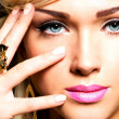 Beautiful face of young woman with fashion makeup — Stock Photo