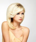 Beautiful blond woman with style hairstyle — Stock Photo