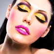 Beautiful face of a woman with fashion makeup — Stock Photo