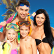 Happy fun family with two children at tropical beach — Stock Photo #24387735