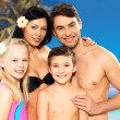 Happy family with two children at tropical beach — Stockfoto