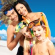 Happy fun family with two children at tropical beach — Stock Photo #24387753