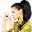 Royalty-Free Stock Photo: Woman with golden nails and precious stone emerald