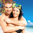 Fun beautiful couple at tropical beach with swimming mask — Stock Photo