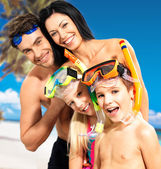 Happy fun family with two children at tropical beach — Stock Photo